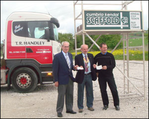 President Roger Frank (centre) receiving cheques of £1,000 from Mr Donald Handley of T R Handley & Sons (left) and Mr Roland Bowman of Kendal Cumbria Scaffolding Company (right).