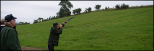 John Bainbridge trying to bag a clay at the clay pigeon shoot at  Flitholme Farm