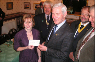 17 November 2009. Claire Lumley accepts cheque on behalf of Cancer Research