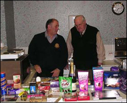 10 December 2009. Ivor and Colin guard the lavish prizes